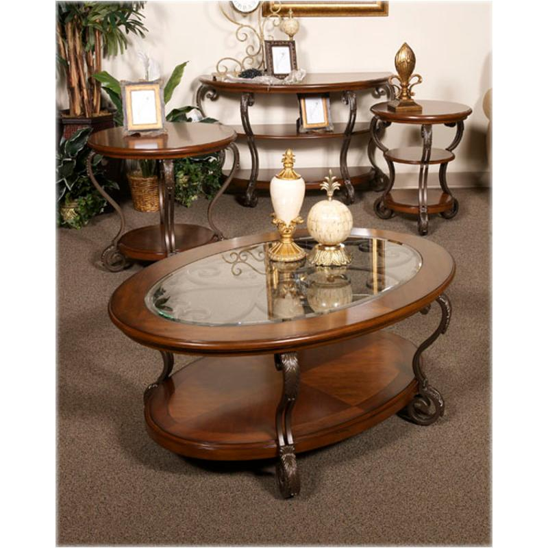 T517 0 Ashley Furniture Nestor Medium Brown Oval Cocktail Table